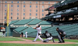 BALTIMORE, MD - APRIL 29:  Chris Davis #19 of the Baltimore Orioles hits a three-run home run in the first inning against the Chicago White Sox at Oriole Park at Camden Yards on April 29, 2015 in Baltimore, Maryland. The game was played without spectators due to the social unrest in Baltimore.  (Photo by Greg Fiume/Getty Images)